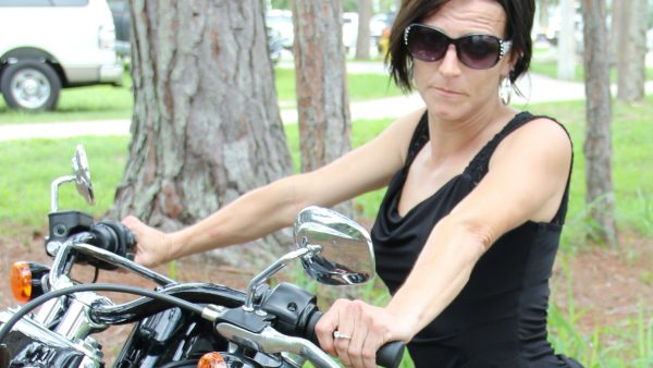 BRUNETTE ON A BIKE by Miserable George